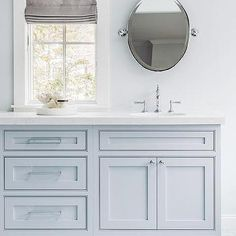 Blue master bath boasts a blue washstand topped with white quartz fitted with an oval sink and vintage polished nickel faucet tucked under an oval pivot mirror. Blue Bathroom Vanity, Marble Bathroom Floor, White Marble Bathrooms, White Bathroom Cabinets, Bathroom Colors, Small Bathroom, Master Bathroom, Bathroom Ideas, Gray Vanity