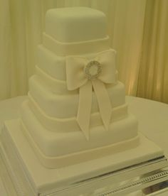 Four Tier Wedding Cake With Sugar Formed Central Bow Adorns This Simple Elegant Design