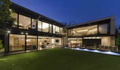 We love the impressive exterior glazing on this large modern home.  Design: http://www.grupoarquitectura.com/