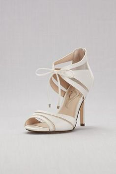 a6a51e114c3 Sheer mesh insets and ankle ties give these heels an edge that makes them  as perfect