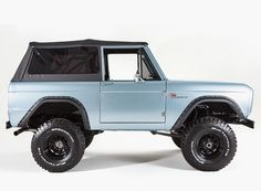 this classic ford broncos is named the 'san francisco' and features a powder blue exterior finish, supple brown leather seats with a brand new coyote 5.0 engine, all in a 1974 donor shell.