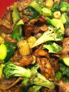 Love cooking our signature dish  Chicken thigh fillets and broccoli zucchini mushrooms baby corn - food glorious food