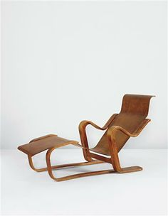 "MARCEL BREUER  ""Long Chair"", circa 1935    Bent birch plywood.    29 x 55 1/4 x 24 1/4 in. (73.7 x 140.3 x 61.6 cm)    Manufactured by Isokon Furniture Company Ltd., UK."