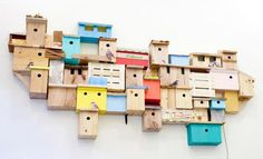 Favella-inspired birdhouses give city birds a place to nest.