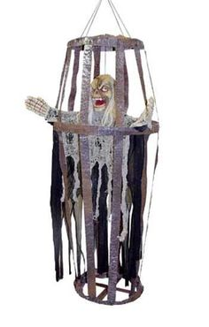 """Rotten Reaper in Cage.  Looks like the cage that held Ice and Jay.  Another cool prop for your """"Hocus Pocus Halloween Party."""" If you get this, you must dangle sneakers from it!"""