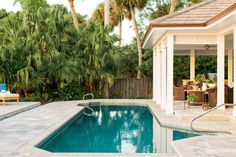 Just outside the kitchen door is the covered lanai and pool which is surrounded by pinkish gray pavers. The lanai has a dining area with a resin capped table and comfy chairs. An entertaining area nearby is set up like and outdoor living room.