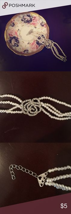 Beautiful Faux Pearl and Crystal Bracelet This is a beautiful piece and can dress up any outfit. It is small faux pearls with a crystal flower in the middle!! It has a lobster claw closure and is slightly under 8 inches long from end to end. It was never worn and is in excellent condition  Jewelry Bracelets