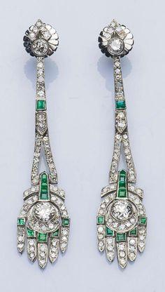 A pair of early Art Deco platinum, diamond and emerald ear pendants, circa 1910. #ArtDeco #earrings