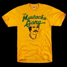 "Cool Shirt! To the truly sports-minded facial hair appreciators on your list—and in honor of the Fab.com team's commitment to Movember's moustache month—this bright retro-styled T-shirt will strike the right note. Designed in homage to the 1972 World Series, when the mustached Oakland A's faced the clean-shaven Cincinnati Reds (a series the media dubbed ""the hairs vs. the squares"") and won, the Mustache Gang tee also celebrates today's once again furry-faced players."