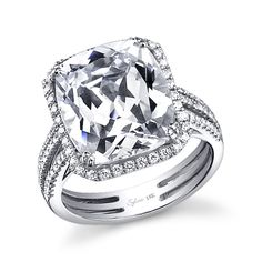 Style# SY562 Classic Cushion Cut Diamond Engagement Ring - This beautiful white gold diamond engagement ring features a 8 carat cushion cut center with a total of 0.51 carats in our signature halo and split shank. https://www.sylviecollection.com/classic-cushion-cut-diamond-engagement-ring-sy562