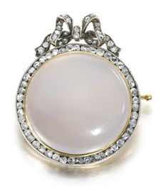 A Fabergé moonstone and diamond brooch, Moscow, 1899-1908, in neoclassical taste, the circular moonstone within a border of rose-cut diamonds, below a diamond-set ribbon bow surmount, gold mount, pin and safety chain.