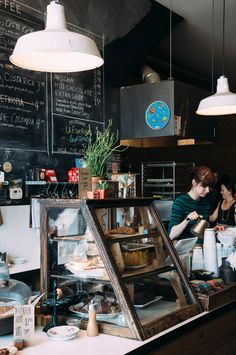 Detroit: Astro Coffee - Kinfolk Love the case lamps and wall style Find a cabinet like this ..