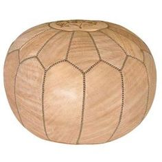 """Add a pop of exotic style to your living room or master suite with this eye-catching leather pouf, showcasing Moroccan-inspired stitching and a chic champagne hue.     Product: Pouf   Construction Material: Leather   Color: Champagne  Features: Moroccan-inspired stitching   Dimensions: 12"""" H x 20"""" Diameter   Cleaning and Care: Professional cleaning recommended"""