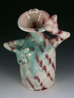 Claymonster Pottery. LOVE this stuff... wish I had one :)