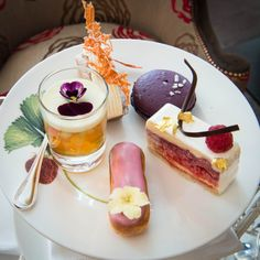 High Tea at the Brown Hotel, London - warm scones with rose and strawberry jam, violet macaroons, carrot and jasmine cakes, raspberry and white chocolate mousses, rosewater éclairs and Pimms jellies along with a selection of freshly prepared sandwiches.