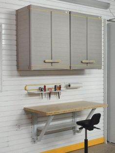 Two wall cabinets, a wall mounted workbench, a tool holder and towel rack. Use the cabinet top and the inside bottom for additional storage - GT541E