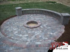 paver patios - looks like a built in fire pit to me! Paver Stone Patio, Paver Stones, Brick Pavers, Round Pavers, Fire Pit Patio, Fire Pits, Wall Seating, Outdoor Living, Outdoor Spaces