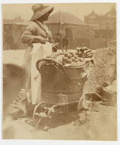 Woman selling fruit from small barrow Sydney, ca. 1885-1890 /photographed by Arthur K. Syer by State Library of New South Wales collection, via Flickr v@e