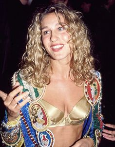 SJP works a super chic metallic bra under her embroidered blazer at the For The Boys premiere in 1991. // #Fashion