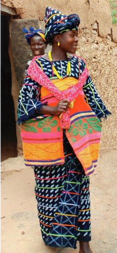 Woman wearing local indigo dyed cloth.  Dogon country, Mali