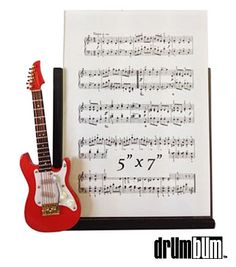This is an awesome frame with an electric guitar attached. Would make a wonderful decor piece for living room, den, study, guitar practice room or studio.   http://store.drumbum.com/skuMGPF-30.html