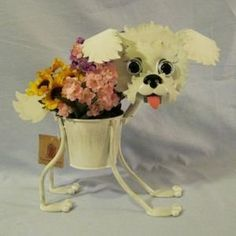 "Bichon Frise indoor or outdoors (garden) décor plant stands. Holds 4"" pots - 13"" inches tall by Georgetown Home & Garden. $32.25. marble eyes. minimal assembly, no tools required. 4"" diameter pot. 13"" tall. made of durable metal. This bichon frise planter stands alone and holds a 4"" diameter pot.  It is 13"" tall, made of durable metal, weather proof paint, with marble eyes.  Minimal assembly, no tools required."