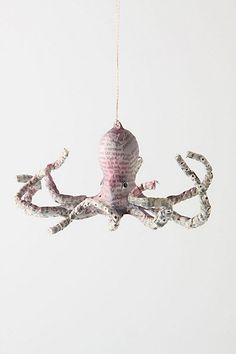 "newsprint papier-mache ""Sea Story Octopus"" ornament from Anthropologie, $16- Bet I can make them?"