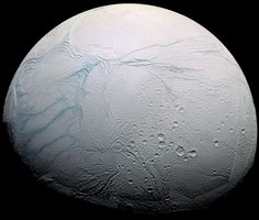 """On Saturn's moon Enceladus, a global, underground ocean vents through features called """"tiger stripes"""" at its south pole (left, in this false-color image). Such alien oceans are prime candidates in the search for life beyond Earth. Photograph by Cassini Imaging Team, SSI, JPL, ESA, NASA"""
