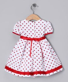 Complete with a hat, silky-soft diaper cover and fancy frock that snaps in back, this charming ensemble makes getting dressed oh-so easy. Plus the pretty flower on the dress' front is attached with a safety pin and can be easily removed for machine washing.