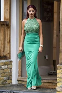Essex beauty:Amy Childs, 25, continued to look immaculate as she headed to Rylan Clark's wedding to Dan Neal from her Brentwood, Essex home on Saturday