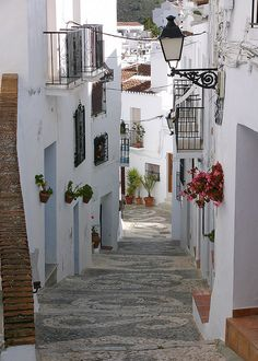 Attractive old street in one of the better known pueblos blancos (white towns) of Andalucia. ✈✈✈ Don't miss your chance to win a Free International Roundtrip Ticket to Granada, Spain from anywhere in the world **GIVEAWAY** ✈✈✈ https://thedecisionmoment.com/free-roundtrip-tickets-to-europe-spain-granada/