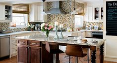 Like the 3 side seating island; don't care for the counter top or cabinetry.