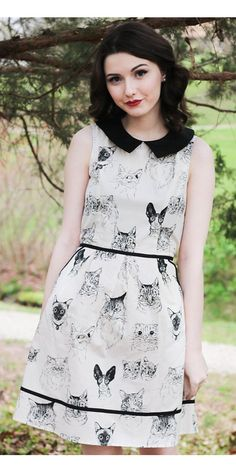 Purrfectly simple is the Purrfect Occasion Dress. This Dress fantasic for any cat lovers out there, as it's covered with all sorts of cat faces. The fitted bodice has darting that the bust for added structure. Sleeveless with a high Peter Pan collar a classic look for anyone. Flared out at the waist and accentuated with black piping, also near the hem of the skirt. Going out on the town try it with some flats or maybe a cute air accessory.