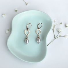 Grey pearl earrings! These would make a great Mother's Day gift