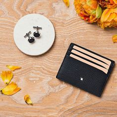 Montblanc cufflinks and leather card holder make for a classy thank you for your groomsmen
