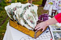Pretty vintage fans allow guests to cool off at outdoor venues.