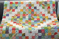 orange you glad: potluck scrap quilt throw with white diamond.