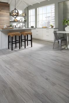 Want the feeling of relaxed living? The soft gray tones of Oceanside Oak offer a beautiful backdrop for any space in your home. Plus, wood-look tile is waterproof!