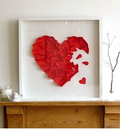 This would be easy to make framed heart with petals of hearts coming out of it.. paper art. use flowers he's given you.