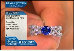 Brilliant blue sapphire set in an 18k gold and diamond mount.