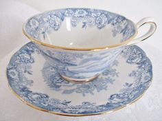 A pretty blue and white teacup and saucer set by Jackson & Gosling, Grosvenor China, England. The backstamp reads Ye Olde English. A pretty