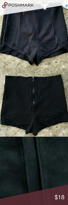 "NWT Silence & Noise cheeky shorts. Size Medium Black fitted Silence & Noise cheeky shorts. Mesh stripe down each leg. Zips up back. Waist 29"" Rise 12"" Inseam 2"" Fabric rayon/nylon/ spandex blend Urban Outfitters Shorts"