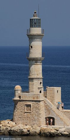 The lighthouse of Chania on the Island of Crete, Greece.  The lighthouse tower is mounted on a trapezoidal base and stands 21 metres high and is visible for 7 miles.