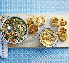 Falafels with houmous & tabbouleh. Make your own chickpea and butter bean fritters and serve with a herby couscous salad - the recipe makes enough for two meals