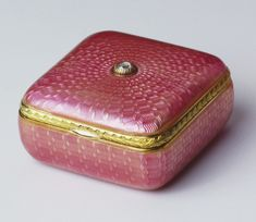 Fabergé square box of silver-gilt with translucent magenta weave guilloché enamel and chased laurel border of red and green gold with plain thumb-piece, a rose diamond is set at the centre of the hinged lid. Mark of Michael Perchin, 1903. Probably acquired by Queen Alexandra.