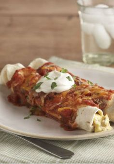 Chicken and Sour Cream Enchiladas – Rolled up with tender chopped chicken and salsa in a luscious sour cream and cheese sauce, these weeknight-quick enchiladas are a surefire family pleaser on the dinner table.