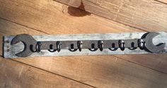 Used an old wrench and attached some hooks for hanging keys or maybe coffee cups ... Mounted to a piece of reclaimed lumber