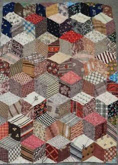"""A charm quilt from 1870-1900, a single diamondshape. The goal was no two pieces alike. Third Time's A Charm28"""" x 36""""405 PiecesI just finished binding this hand pieced, hand quiltedcharm quilt. There a"""