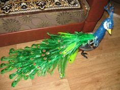 Make beautiful peacock design with waste plastic bottles.This is a simple design to make, which adds beauty to our home. In many countries, the peacock Recycled Art Projects, Recycled Crafts, Handmade Crafts, Easy Crafts, Arts And Crafts, Diy Projects, Plastic Bottle Crafts, Plastic Bottles, Garden Animals