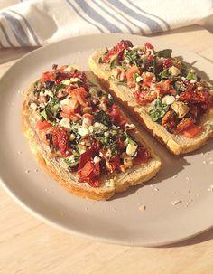 ... Bread with sun-dried tomato pesto, spinach, Roma tomatoes, Feta and